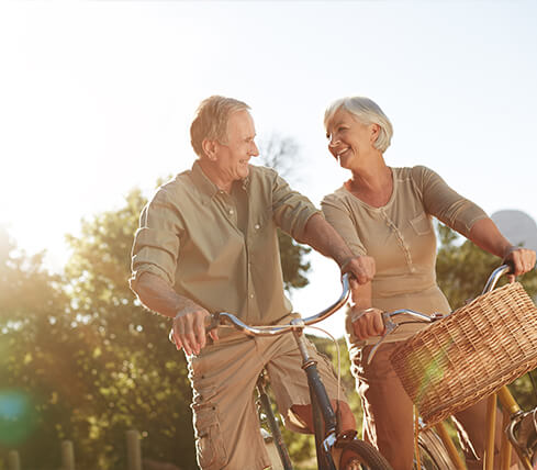 senior couple outside riding bikes together