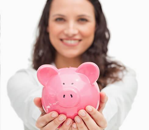 woman holding a pink piggy bank